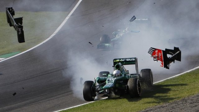 Giedo Van Der Garde crashes out on the first corner at the Japanese GP