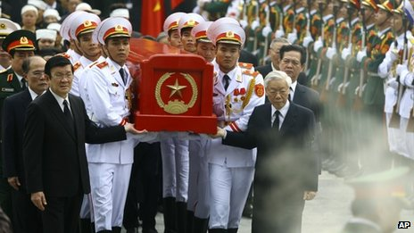 Soldiers carry General Giap's coffin, headed by Vietnam's most senior political leaders