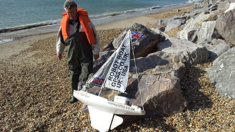 Robin Lovelock on the beach at Barton-on-Sea with his Snoopy Sloop boat