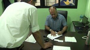 Birendra Bahadur Basnet signing paperwork