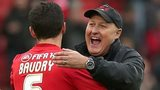 Russell Slade celebrates with his players