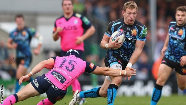 Exeter wing Matt Jess charges past the tackle of Blues full-back Leigh Halfpenny