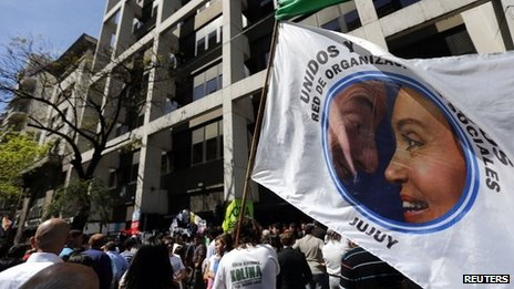 Supporters wave banner with photo of Cristina Fernandez de Kirchner