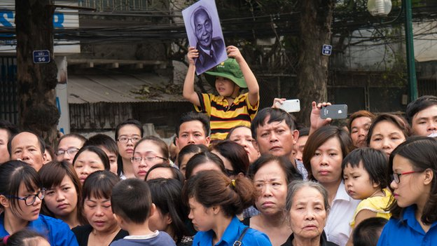 A crowd awaits General Giap's funeral procession