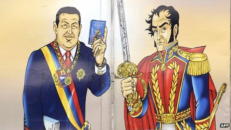 A drawing of late Venezuelan president Hugo Chavez and Simon Bolivar on a lorry in Caracas on 16 September, 2013