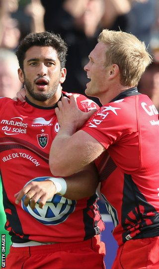 Maxime Mermoz celebrates with Toulon team-mate Michael Claassens