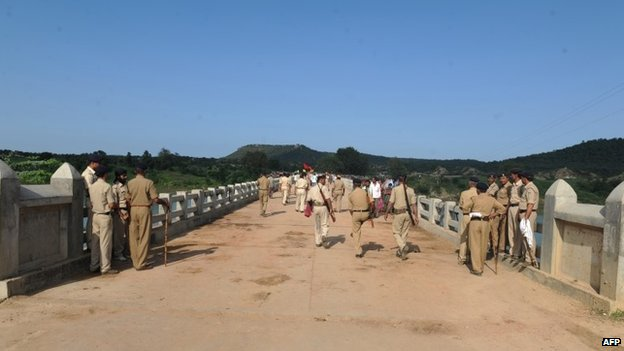 policemen walk on the bridge where a deadly stampede took place the previous day near the Ratangarh temple in the Datia district of central Madhya Pradesh on October 14, 2103