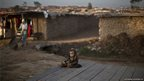 An Afghan refugee child sits on roadside on the outskirts of Islamabad, Pakistan