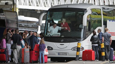 Poles boarding bus at Victoria Station, London, 20 May 09