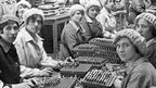 Women munition workers finish small arms cartridges in a factory in London