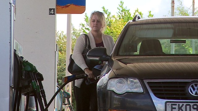 woman fills car with petrol