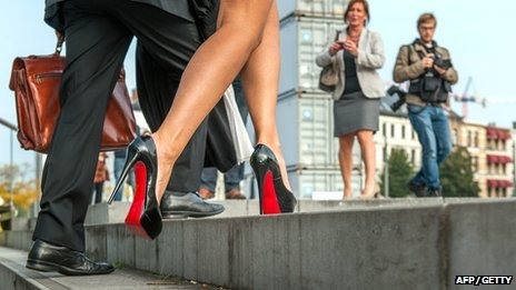 woman wearing red soled stilettos