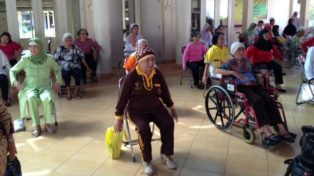 Residents exercising at an old folks home in Indonesia
