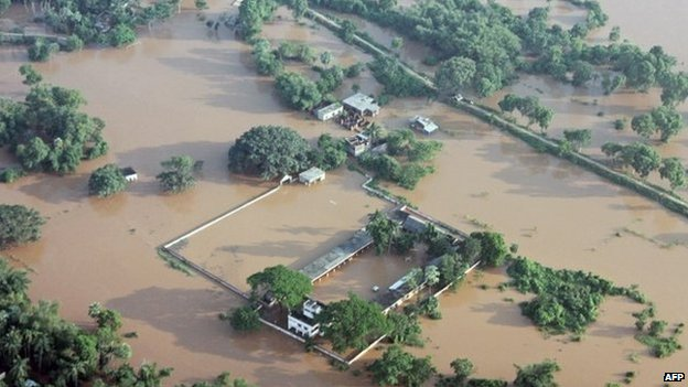 This handout photograph released by the Ministry of Defence shows a flooded area near Balasore following Cyclone Phailin on October 14, 2013