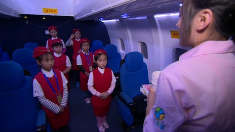 "Young girls dressed up as flight attendants at the ""I Have a Dream"" theme park in Beijing October 2013"