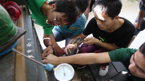 Male students work on an engineering project at the China Mining and Technology University in eastern Jiangsu province, October 2013