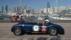 A C-Type Jaguar is driven through the Olympic sailing venue in the Chinese coastal city of Qingdao
