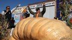Gary Miller celebrates after winning the 40th Annual Safeway World Championship Pumpkin Weigh-Off