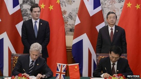 "George Osborne and Chinese Vice premier Ma Kai watch over  Paul Deighton, commercial secretary to the Treasury Xu Yongsheng, deputy director of China""s National Energy Administration in signing ceremony"