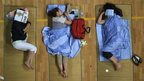 Parents of university students sleep in a gymnasium in Huazhong Normal University