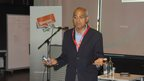 George Alagiah speaking to students