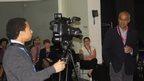 Student filming Alagiah speaking
