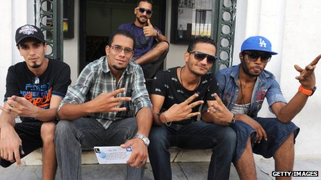 Tunisian rappers Seif Khrissi (Tuniaif), Bilel Matmati (MC Bilel), Mohamed Soufienne (Jok boss), Moez Belhaj (T-Gang) and Mohamed Kadri (BMG) pose after a press conference to announce the creation of a rapper trade union in Tunis