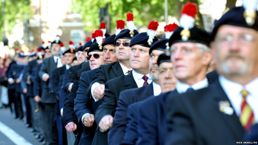 Former Fusiliers march along Whitehall in protest at government plans to scrap their battalion