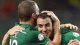 Richard Dunne congratulate goalscorer John O'Shea