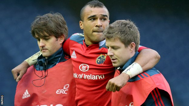 Simon Zebo is helped off the pitch after suffering the foot injury