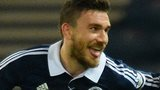Robert Snodgrass celebrates his goal for Scotland with Barry Bannan
