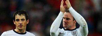 England defender Leighton Baines and team-mate Wayne Rooney