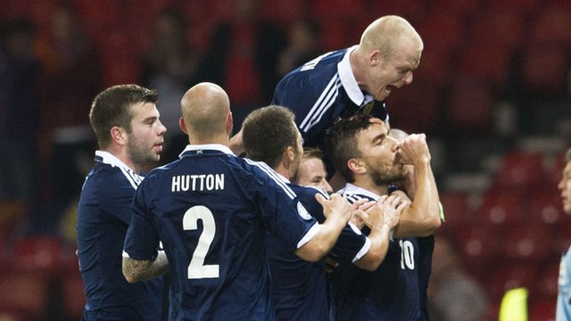 The Scotland players congratulate Robert Snodgrass on his goal
