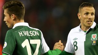Craig Bellamy and the youngest player in Welsh history, Harry Wilson