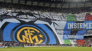 Inter Milan supporters waving an Inter Milan flag