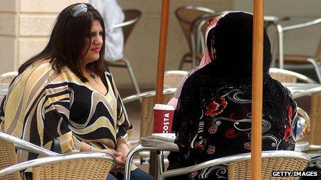 Women sit in a Kuwait City coffee shop
