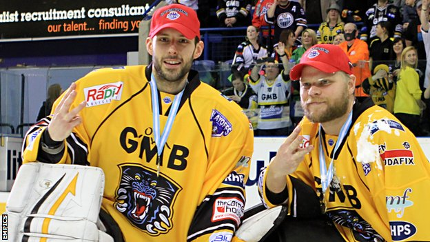 Dan Green and Craig Kowalski celebrate winning the Elite League trophy in April