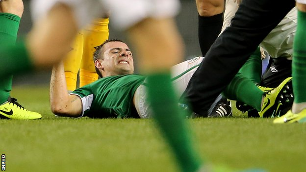 Darron Gibson looks in pain after being injured during the Republic of Ireland's game against Kazakhstan