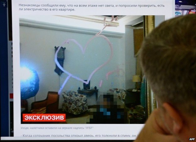 A man looks at a computer screen in Moscow, 16 October