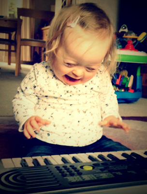 Rosie playing electric keyboard