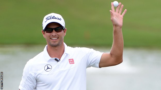 Adam Scott celebrates winning the PGA Grand Slam of Golf