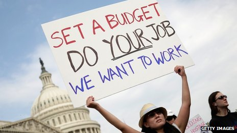 A furloughed federal worker protested outside the US Capitol on 4 October