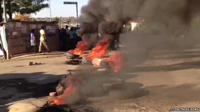 Residents in Diepsloot, South Africa, set tyres on fire in anger after the deaths of two toddlers