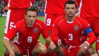 Bellamy lines up with team-mate and close friend Gary Speed prior to Wales' Euro 2004 qualifier against Italy at the Millennium Stadium in October 2002