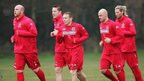 John Hartson, David Partridge, Robert Page and Robbie Savage take part in a Wales training session alongside Bellamy