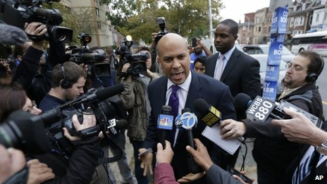 Cory Booker outside a voting station in Newark 16 October 2013