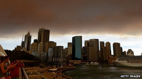 Smoke and ash from wildfires burning across the state of New South Wales blankets the Sydney city skyline on October 17, 2013