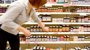 Woman in shop buying vitamins