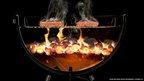 Hamburgers on a BBQ cross-section image