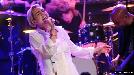 Miley Cyrus performing on Late Night With Jimmy Fallon